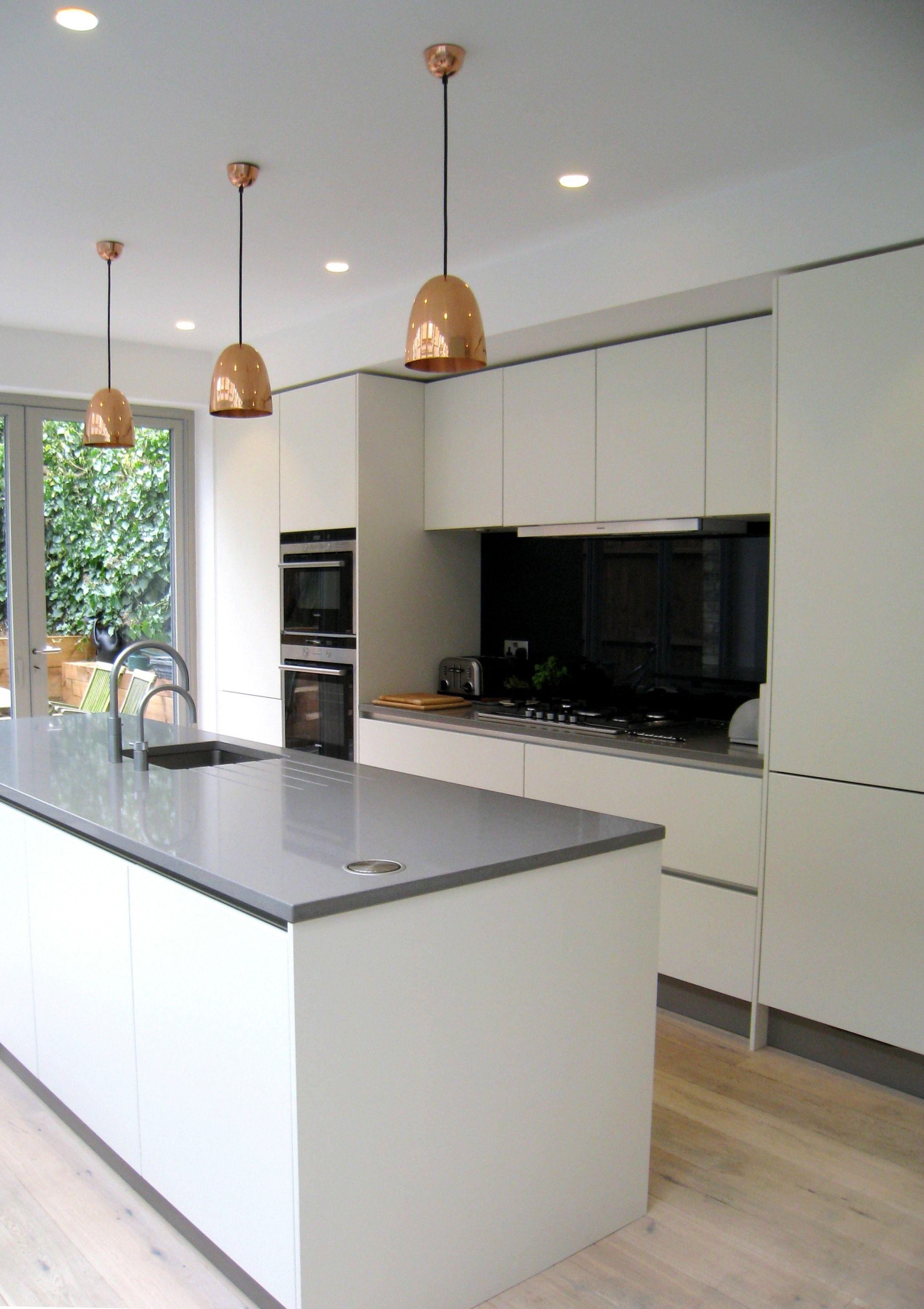Simple yet stunning white satin lacquer, handless kitchen with Vigo ...
