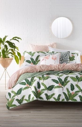 This textured cotton quilt reverses from a vivacious tropical print to microscale patterns, serving as a versatile addition to the bedroom décor.