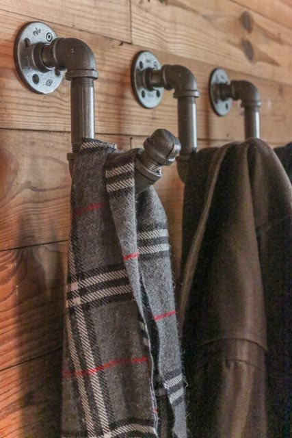 DIY Industrial Pipe Coat Hook - Mount 3 of these on a nice board for towels in the guest bath