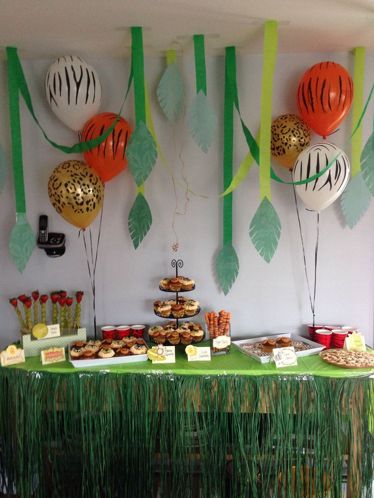 Jungle safari theme first birthday party dessert snack table