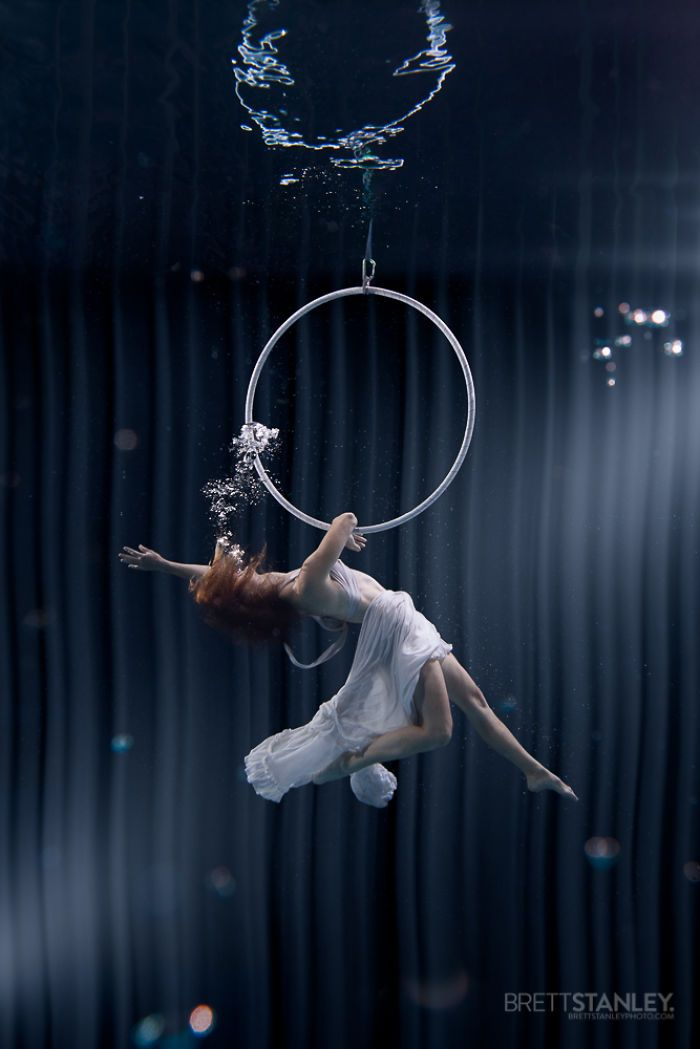 Whilst the word Circus makes us think of clowns and elephants, the other side of that world is the death defying high-wire acts of the Aerial Performers.    These amazing underwater images of performers were created by Los Angeles photographer Brett Stanley as part of a groundbreaking series of photographs showcasing various sports under the water. Brett's previous shots of Pole Dancers underwater received international attention, after going viral last year.