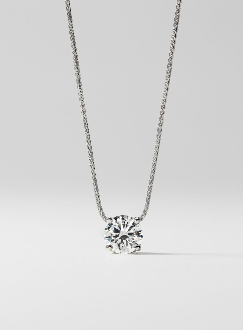 Signature floating diamond solitaire pendant in platinum 080 ct this beautiful platinum pendant showcases a 080 carat brilliant blue nile signature ideal cut round diamond set in a contemporary floating bail design with aloadofball Images