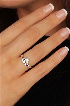 """""""Claddagh Ring Meaning""""    The Claddagh's distinctive design features two hands clasping a heart, and usually surmounted by a crown. The elements of this symbol are often said to correspond to the qualities of love (the heart), friendship (the hands), and loyalty (the crown)."""
