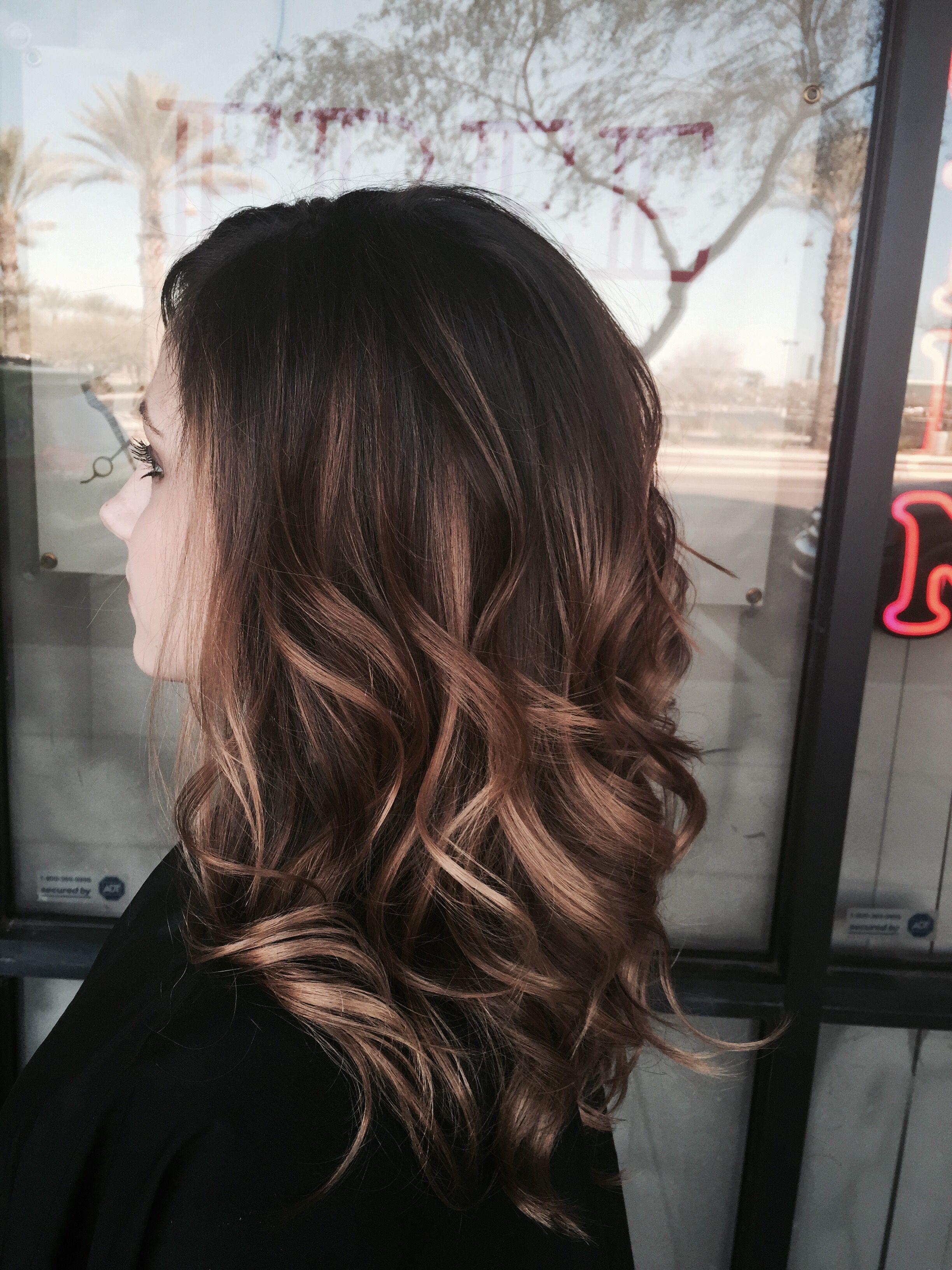 Balayage hairstyle on long hair medium brown with blonde balayage