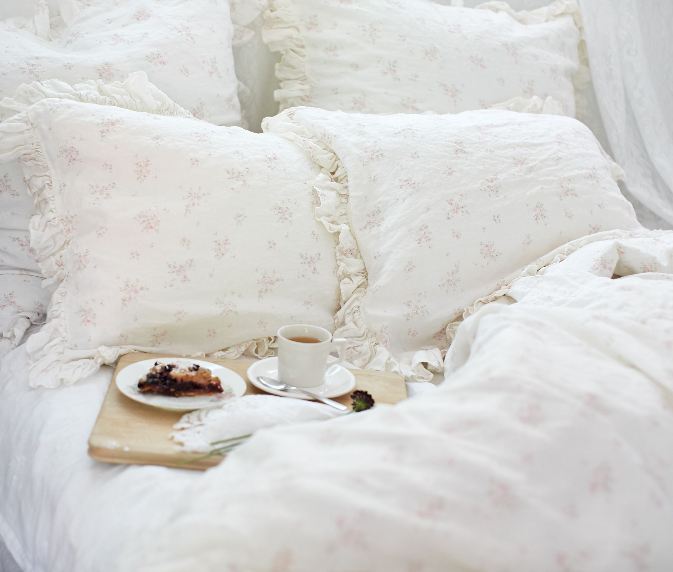 Rosabelle Bedding Collection offers a vintage inspired look through a combination of soft pink flowers over an off-white linen background