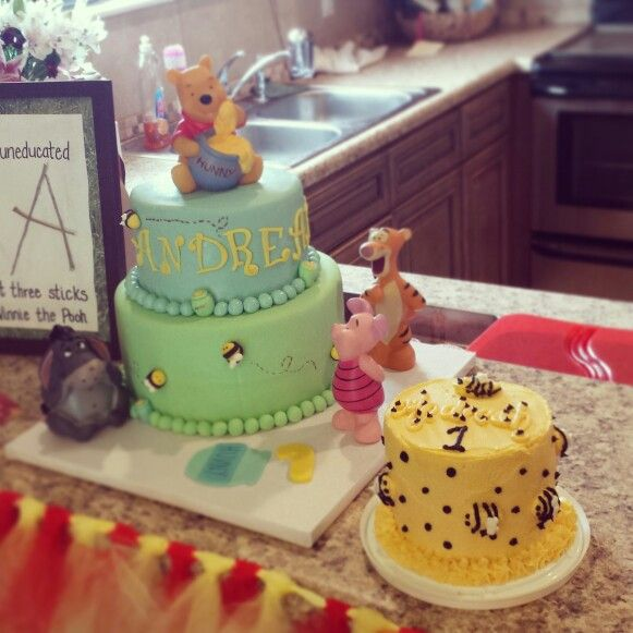 Winnie the Pooh 1st birthday cake with bumblebee smash cake