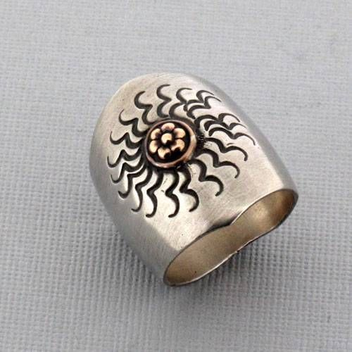 Purple Leopard Boutique - Brushed Sterling Silver Ring Antiqued Celestial Sun Design with Copper Detail, $49.00 (http://www.purpleleopardboutique.com/brushed-sterling-silver-ring-antiqued-celestial-sun-design-with-copper-detail/)