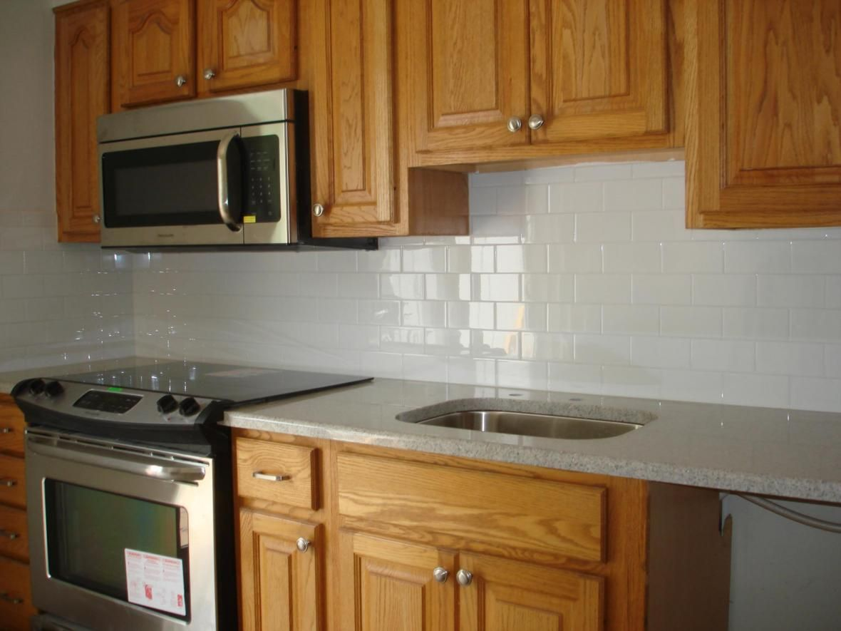 clean and simple kitchen backsplash: white 3x6 subway tile and