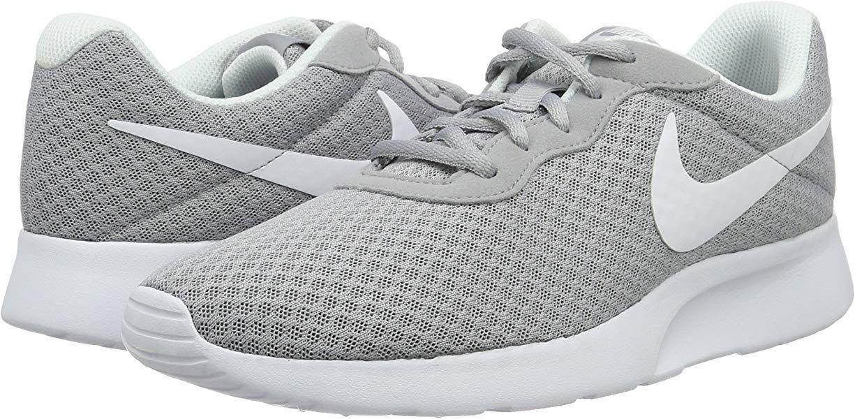 finest selection d42bd 67520 Nike Damen Tanjun Laufschuhe, Grau (Wolfgrau/Weiß), 42 EU: Amazon.de ...