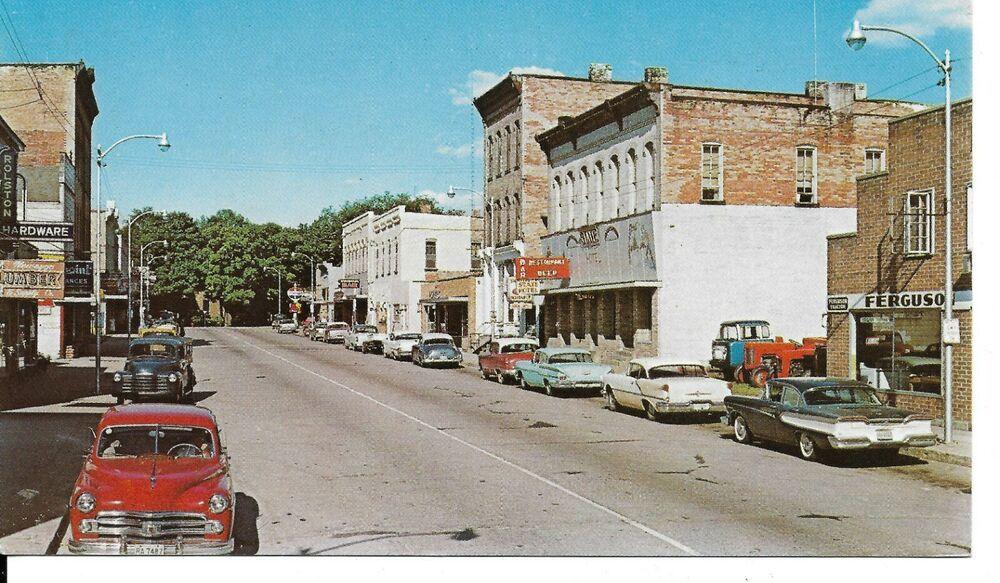Postcard Newaygo Michigan Main Street Old Cars Tractors Signs Postcards Newaygo Michigan Postcard Michigan