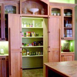 Hidden Pantry - I like the top cupboard above the doors to tie in the look.