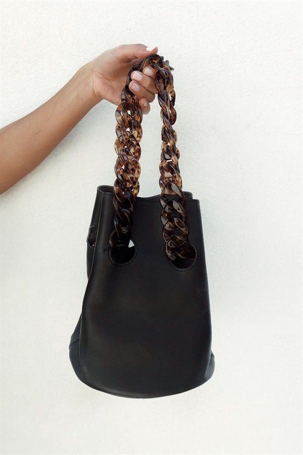 A bucket bag with style! The Tortoise Chain Bag is black and features faux  tortoise 1fb68e6fda1