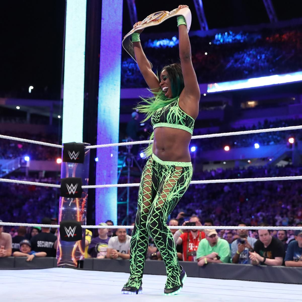 Naomi celebrates with the Smackdown Women's Championship at Wrestlemania 33