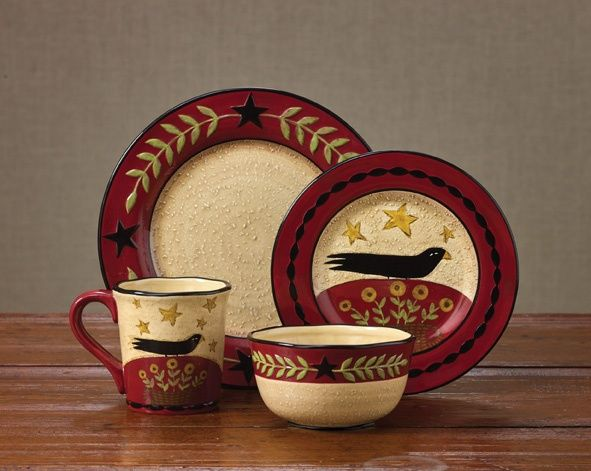 """Dinnerware with Folk Crow Salad Plate from Country Porch Home Decor. With rich red, basic black and gold combined in a folk friendly format, the design coordinates beautifully with many of their country textiles. Design by Teresa Kogut. Hand painted on high fire dolomite. Dishwasher and microwave safe.  Dimensions: 8.5""""Dia  Material: High Fire Dolomite"""