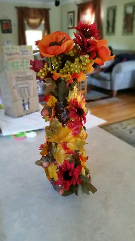 My daughters crafting.. a glass bottle is the base. Happy Fall!