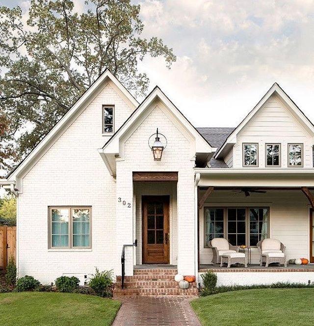 White brick exterior with front porch Modern farmhouse