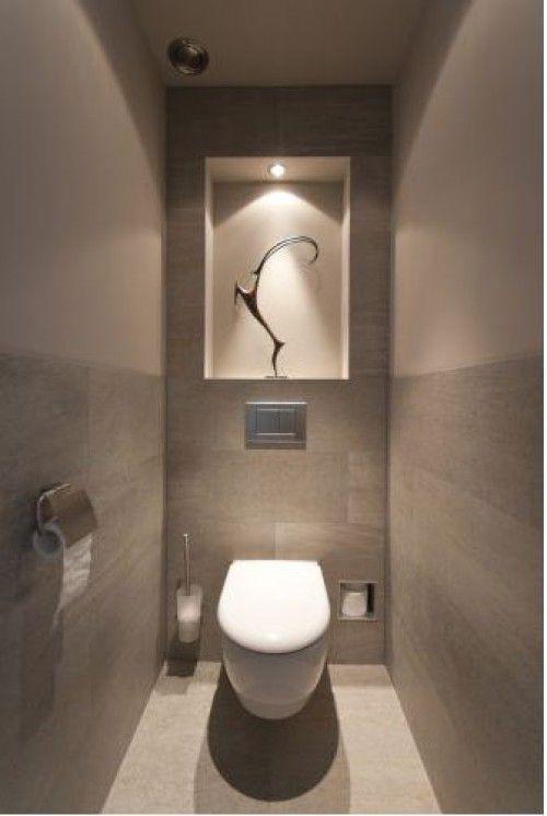 Mogelijke indeling achterwand toilet, leuk met verlichting erin ...