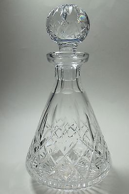 """Up for auction is this cut glass signed Waterford Hand Cut Irish Crystal Lismore decanter It is cut in the old tradition by stone wheel. 10.5"""" Tall with stopper 5"""" in diameter and weighs 3.5 lbs. In v"""