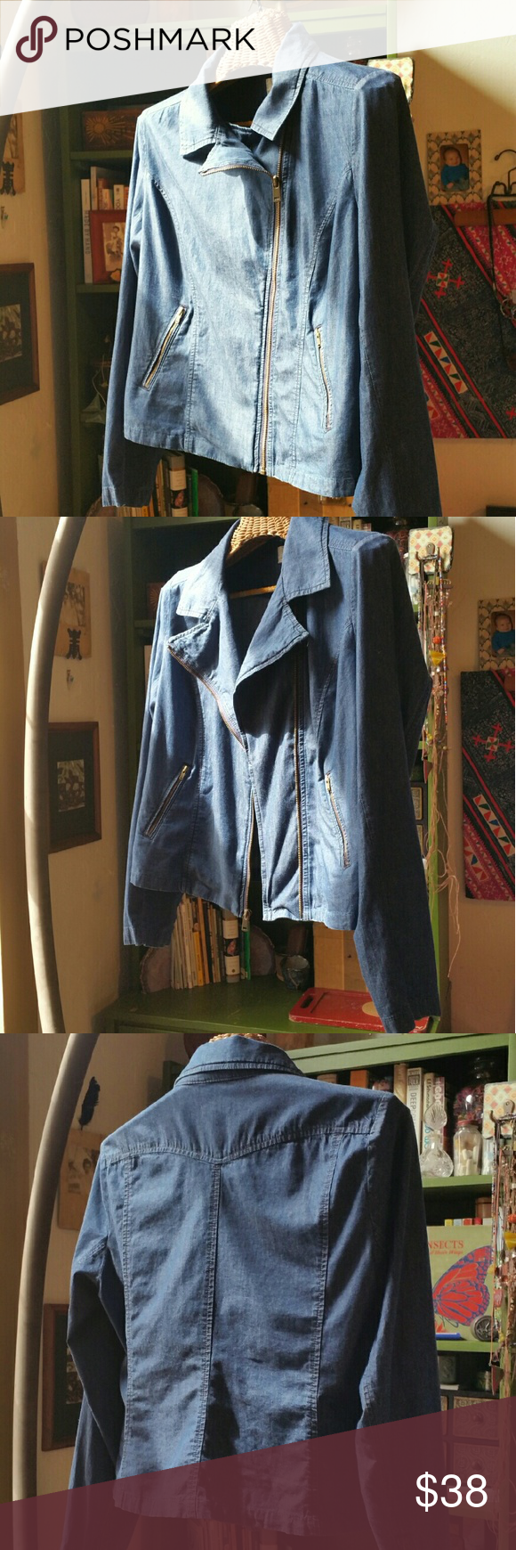 """Levi's deep chambray motorcycle jacket Levi's size large deep chambray/lightweight denim motorcycle jacket  Excellent slant front pocket and sleeve zippers Full asymmetrical front zip 100% cotton Bust 42"""" Total length 21.5""""  **bundle and save 20%!** Levi's Jackets & Coats"""