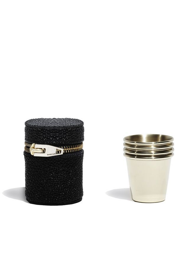 travel bar by Alexander Wang / four pale gold shot glasses in a black snakeskin embossed soft pouch with pale gold zipper closure