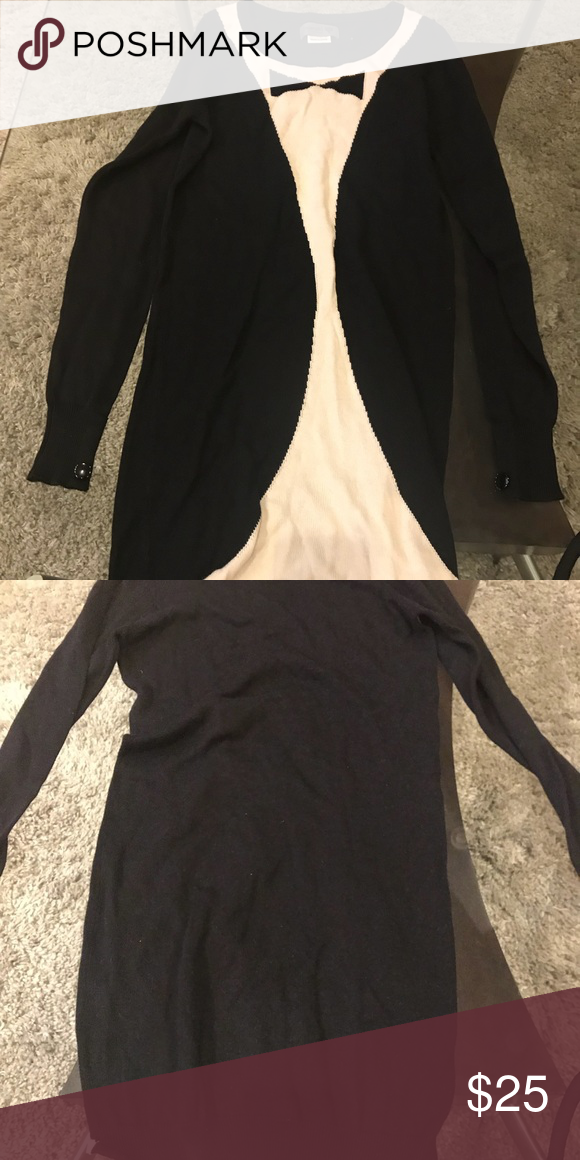 f6ca1f1644812 Gorgeous sweater dress. Tuxedo style Super comfortable. Dress design looks  like a tuxedo and the back is cut as such. Super comfortable.