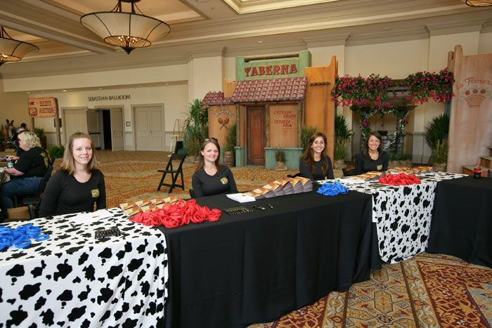 Cow-print linens draped the check-in tables.