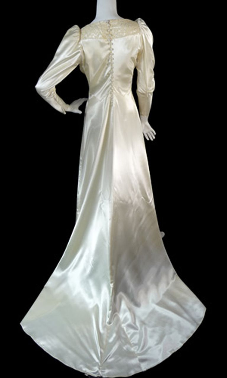 Vintage satin 1940s wedding gown dress with lace and train luxurious slipper satin with lace trim at neckline and a 2 foot train. Pointed sleeve tips, pretty gathered sleeves  bodice and back covered buttons.