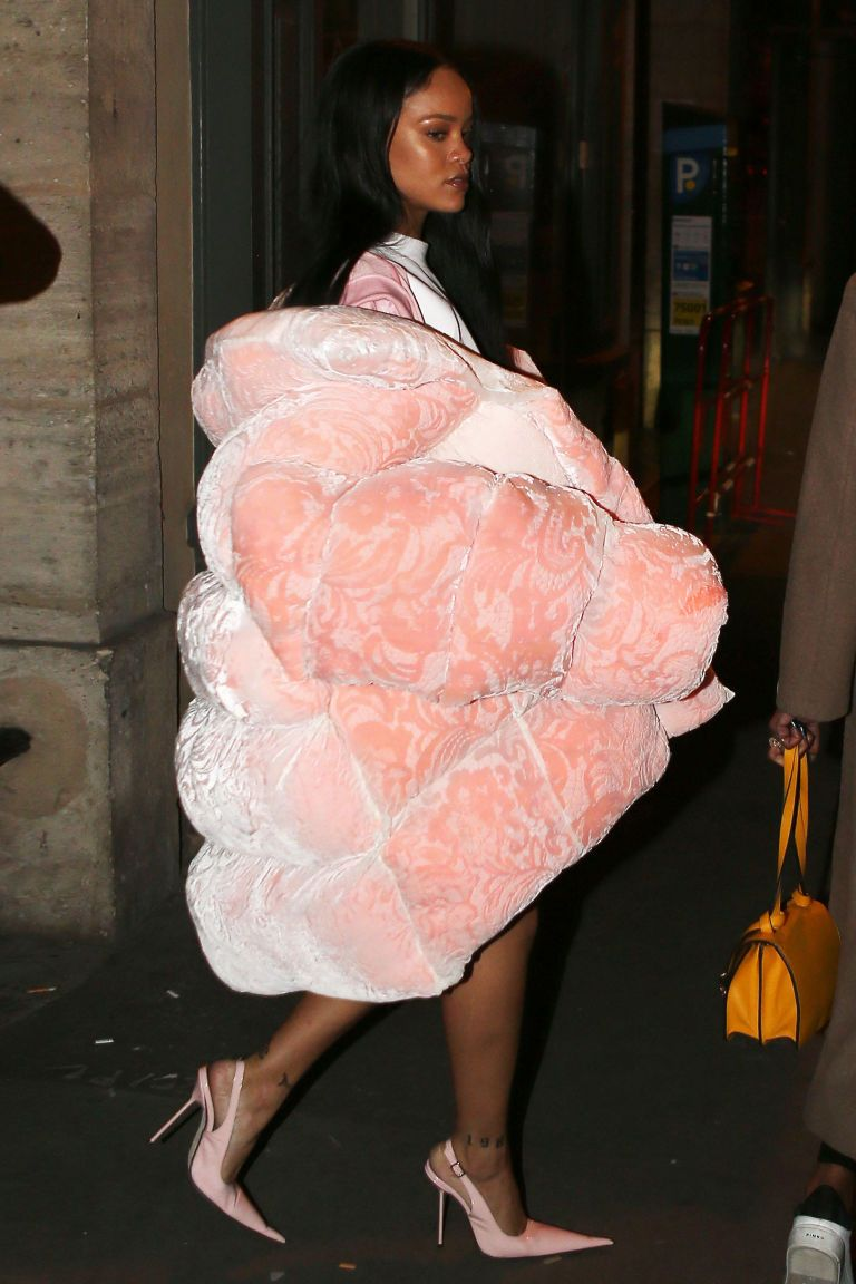 Rihanna can wear anything. No really, anything, including this giant Ella Boucht baby pink coat that she draped over her shoulders last night in Paris. Totally looks like something from a 1990s Missy Elliot video, and we're so here for it.