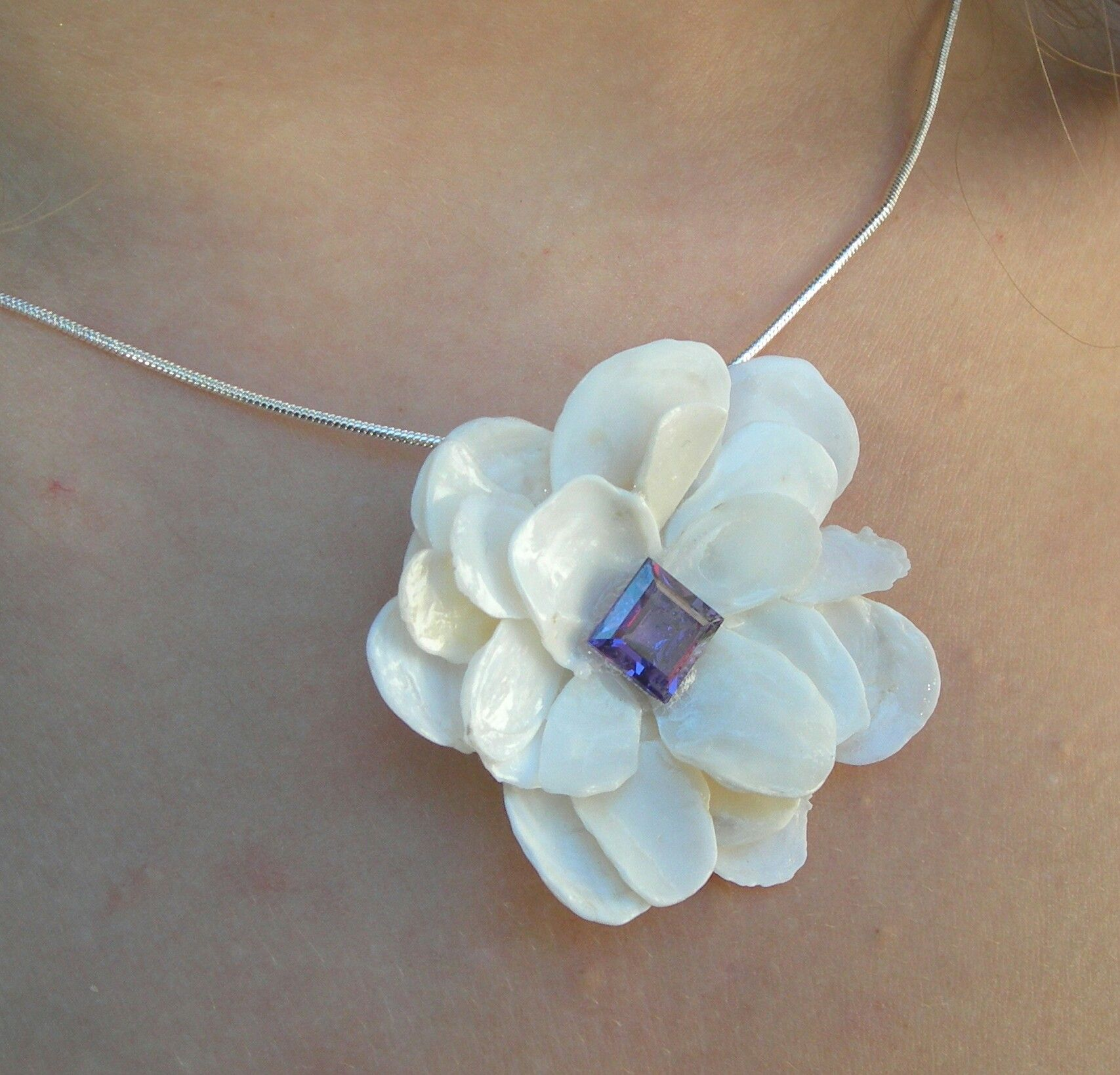 little pieces of shell made into a flower