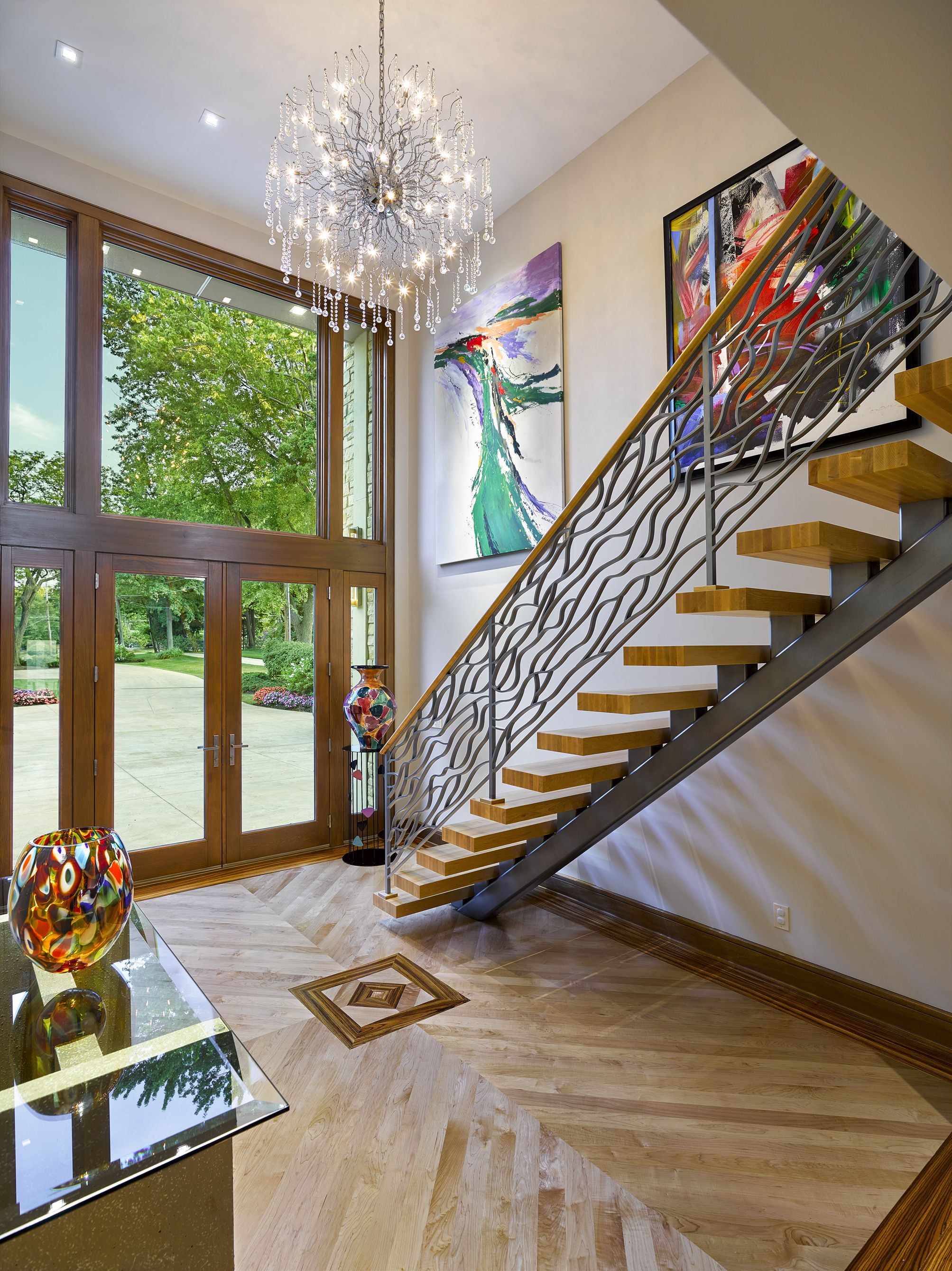 Lovely Elegant Contemporary Foyer   This Dramatic, Floating Staircase Is A  Compelling Design Element In This Contemporary Remodel On The Shores Of  Lake Erie.
