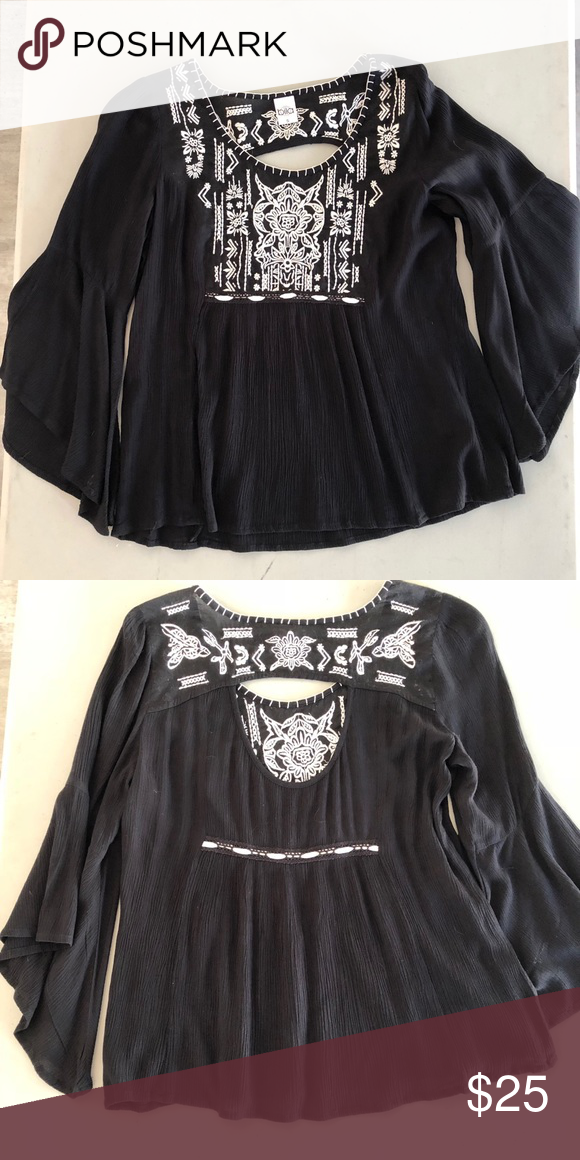 a38e01c36bd Embroidered black top Size small, peek a boo back, front has a beautiful  embroidered print. Sleeves are bell bottomed. Great top to dress up or down.