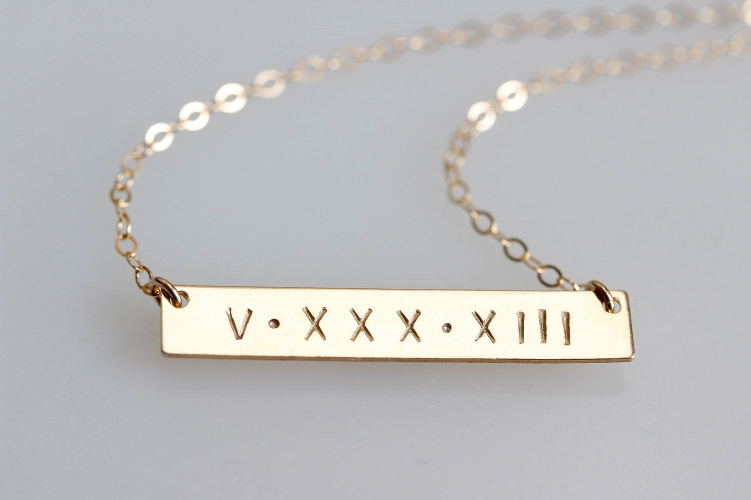 Gold Bar Necklace, ROMAN NUMERAL Necklace, Gold Date Bar, Date Necklace, Initial Bar, Name necklace, Horizontal bar, Monogram necklace by JewelryBlues on Etsy https://www.etsy.com/listing/181859912/gold-bar-necklace-roman-numeral-necklace