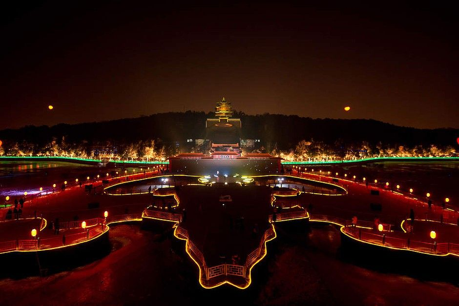 A Lightshow Illuminates The Summer Palace During A New Year Countdown Event In Beijing Celebration Around The World Summer Palace Beijing World Cities