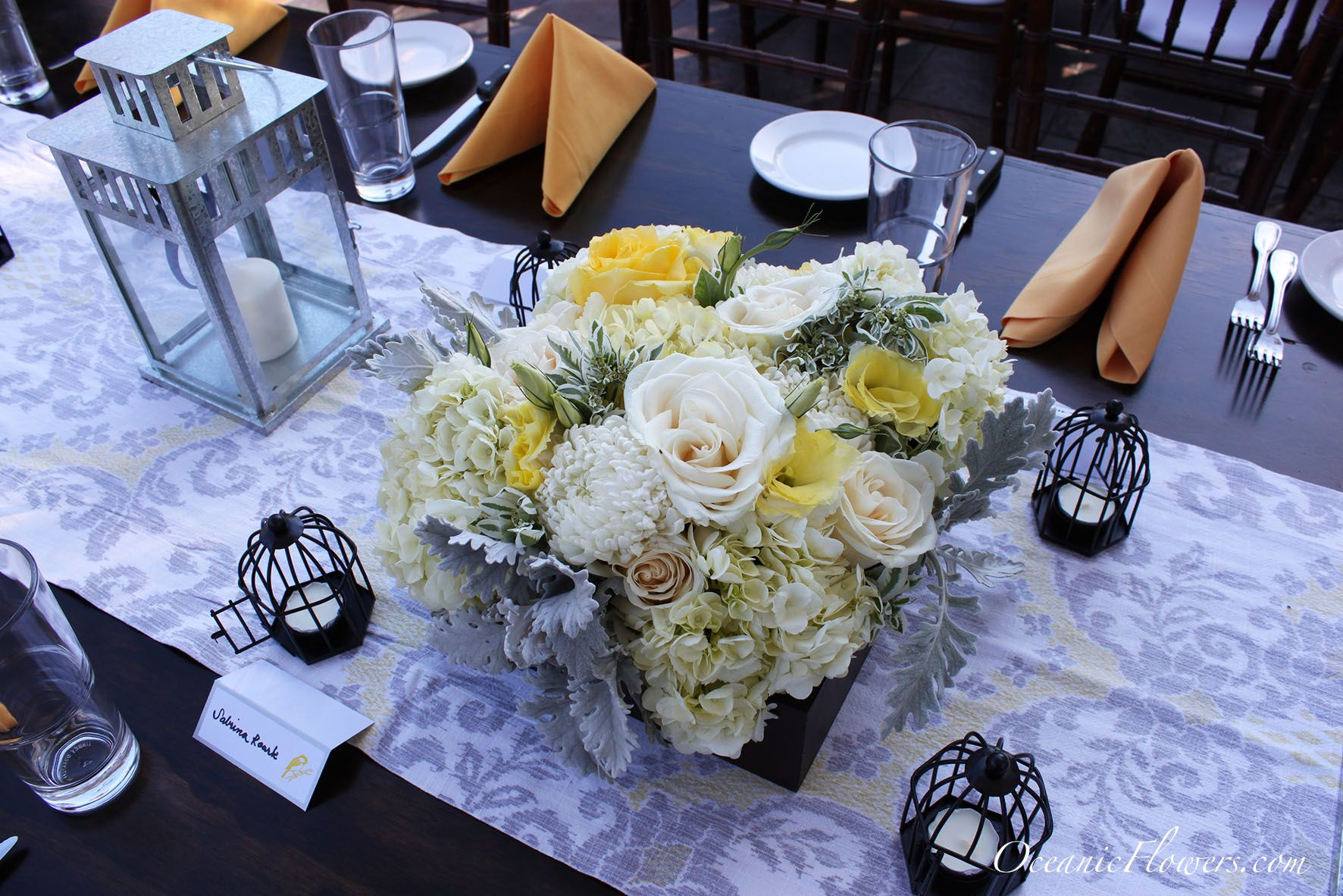 Yellow white and green large box centerpiece with candle light