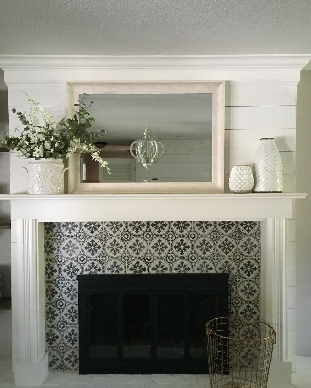 A DIY stenciled fireplace surround using the Abbey Tile Stencil from Cutting Edge Stencils    Project via @co_houseland    http://www.cuttingedgestencils.com/Cement-tile-stencils-stenciled-floor-tiles.html