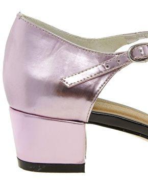 A good kitten, up close. Metallic Mary Jane Heels.