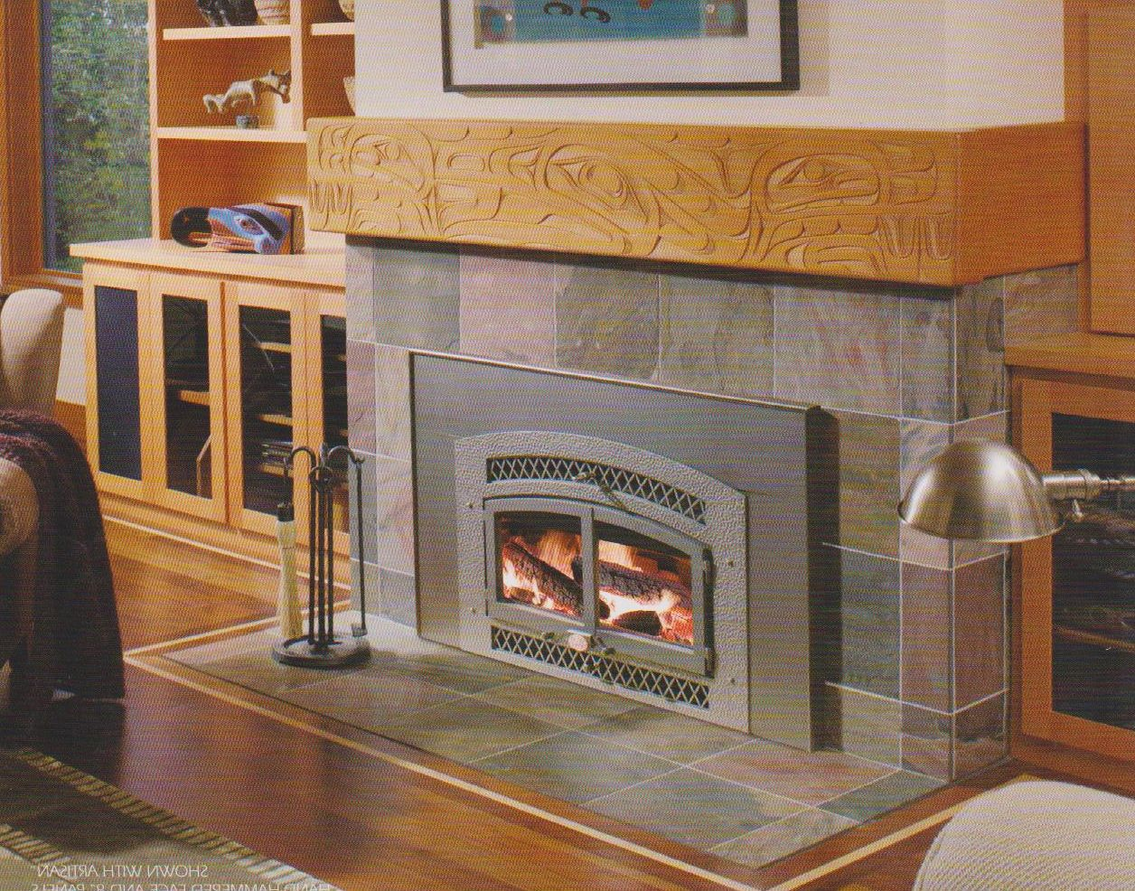Interior Artistic Woodcarvings Burning Fireplace Insert On Stone