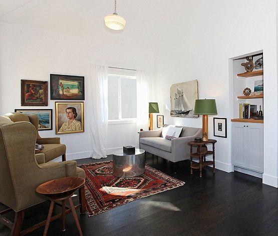 Black wood flooring in living room with brown chairs | Flooring Ideas | Floor Design Trends