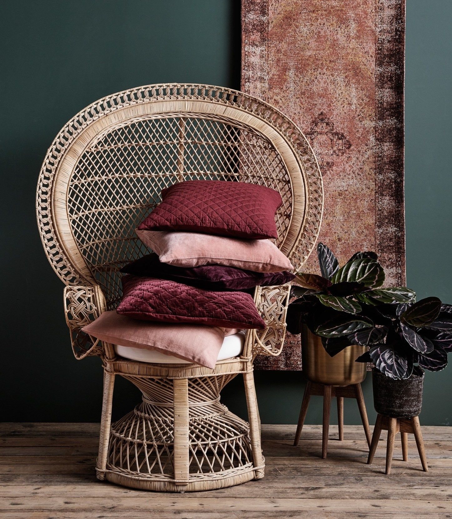 Peacock Chair Piled With Cushions