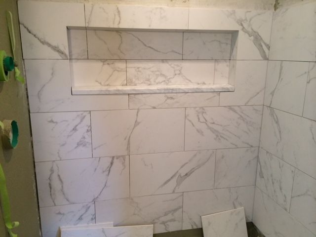 faux carraras marble tile the water closet pinterest - White Marble Tile Bathroom