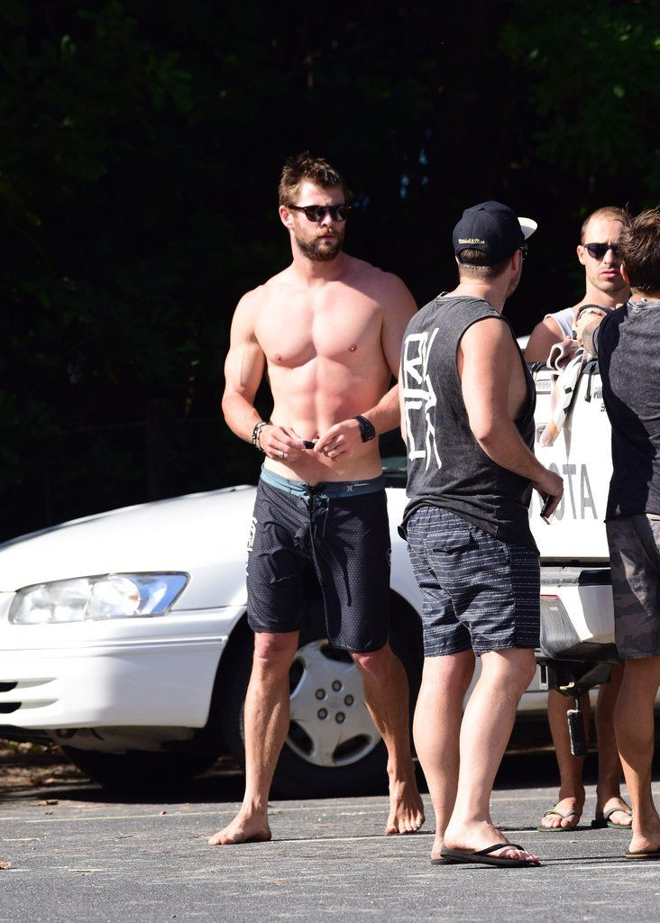 Chris Hemsworth Shows Off Shirtless Superhero Muscles After A Surf
