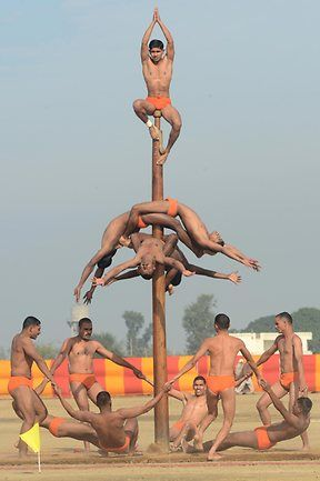 At an India Army Mela gymnasts on a pole. You find paintings of ...