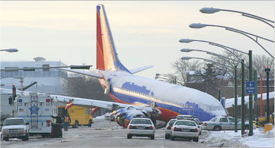 A Midway bound Southwest Airlines jet rests at 55th and Central after skidding off the runway, killing a young boy who was sitting in a car at the intersection, 2005, Chicago