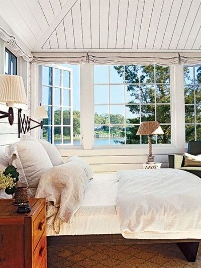beach cottage decor.htm windows all around the bed  water view beach house bedroom  beach house bedroom