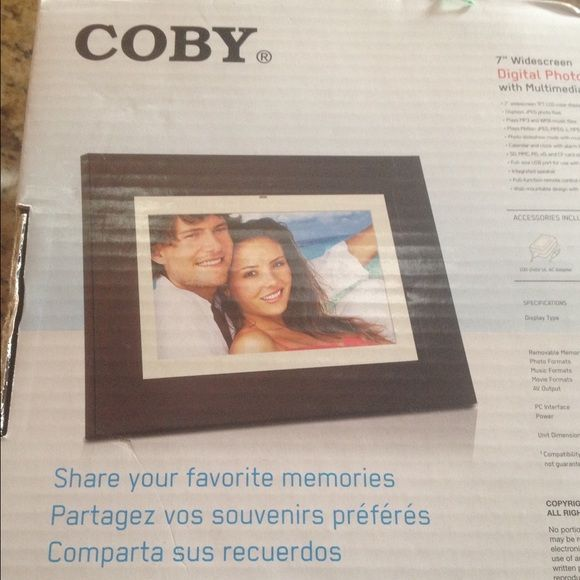 "COBY 7"" digital photo frame.  New in box. Coby brown  digital 7"" photo frame. Slideshow. Bought, never opened. Still packed as original. Accessories included.  AC adapter, remote control, detachable stand, 1 cr2025 battery Coby Other"