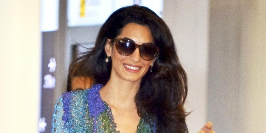 Amal Clooney shows us how to welcome summer in the perfect little dress: http://trib.al/I0ZhjMd