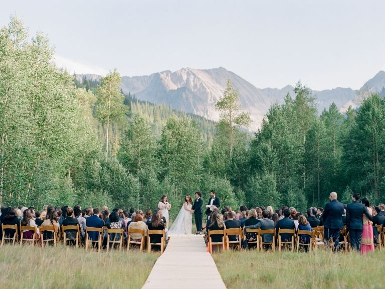The most epic mountain wedding backdrop ever! This gorgeous Aspen Mountain Wedding is simple, natural, and elegant. Photos by Rachel Havel