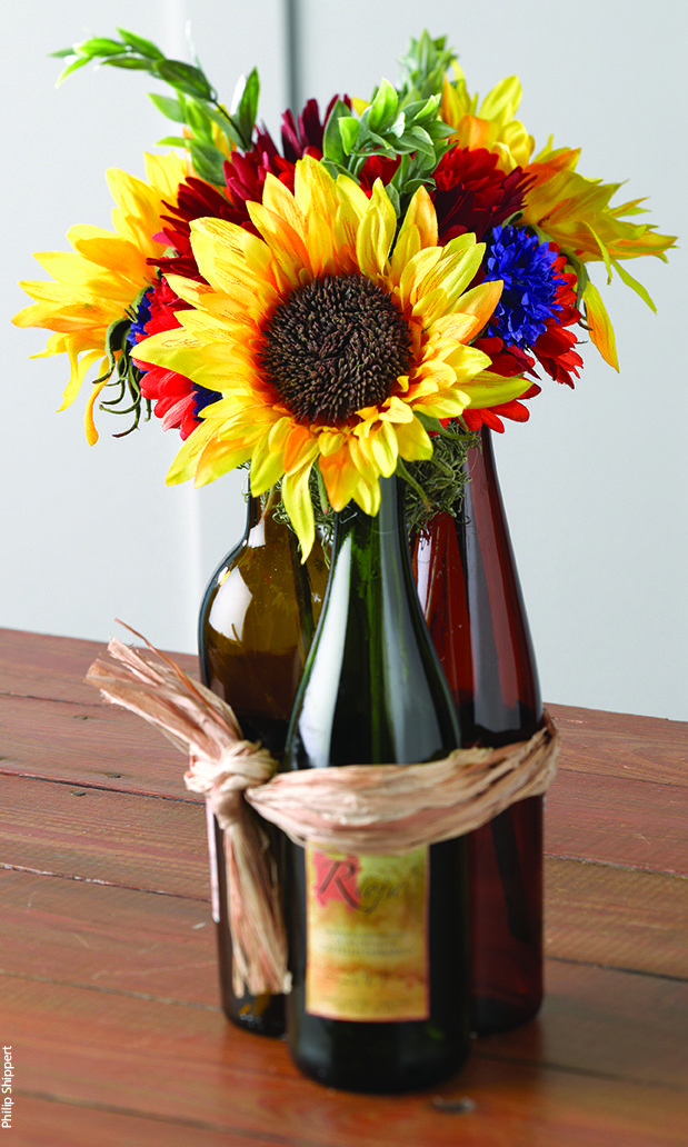 Wine bottle centerpiece i love this possibly add a few for Bottle centerpieces