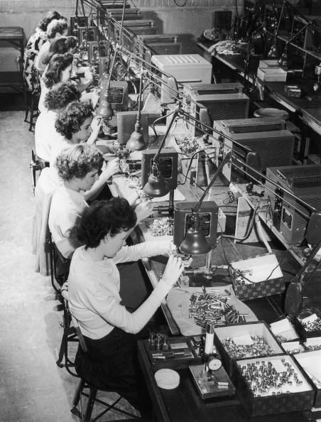 Women in WWII ~ Row of female factory workers assembling machine parts in an American factory during World War II (1939-1945), United States ~ Getty Images ~ BFD