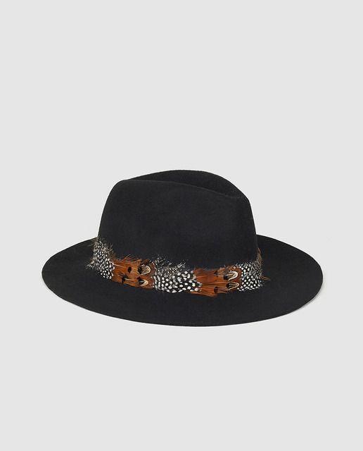 Sombrero negro con plumas  801f46a5e0f